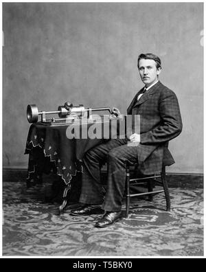 Thomas Edison (1847-1931), using his early Edison phonograph, portrait c. 1877 - Stock Photo