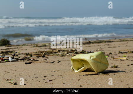 Durban, KwaZulu-Natal, South Africa, plastic pollution, bottle and packaging objects washed up on beach, backgrounds, still life - Stock Photo