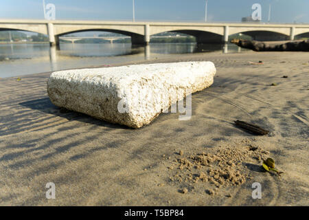Durban, KwaZulu-Natal, South Africa, plastic pollution, piece of white polystyrene packaging material washed up Umgeni river mouth, object, debris - Stock Photo