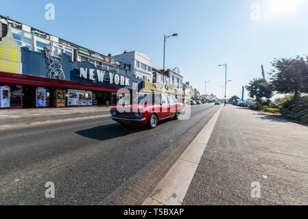 Ford Cortina II classic car at Southend on Sea, Essex, seafront on a sunny day. Driving along Marine Parade passing New York arcade. Space for copy - Stock Photo