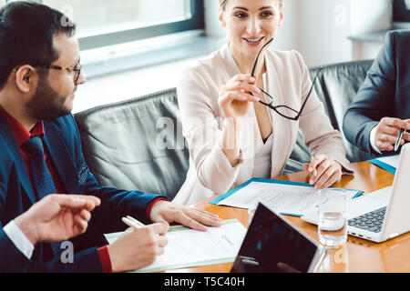 Team of business people working in the office - Stock Photo