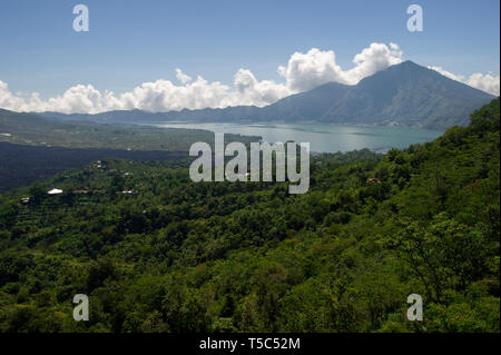 Lake Batur which is located between the active volcano's of Mount Batur and Mount Agung in Bali, Indonesia - Stock Photo