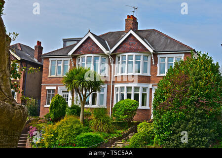 An imposing pair of 1930's style semi-detached houses with traditional bay windows. Overlooking Roath Park in a popular suburb of Cardiff. - Stock Photo