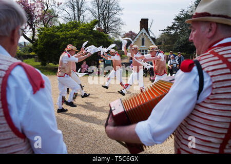 Thaxted Essex England UK 22 April 2019. Traditional Easter Bank Holiday Monday Morris Dancing in Thaxted Church Yard. Thaxted Morris in red and white  - Stock Photo