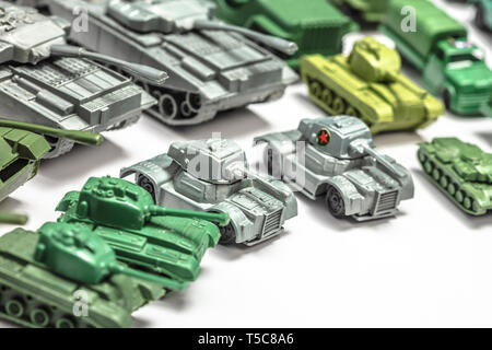 detail of old plastic toys, reproductions of military weapons such as jeeps and armored tanks. - Stock Photo