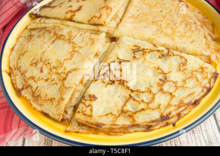 Traditional Russian food, delicious pancakes on a plate, stacked stack. The carnival and seeing the Russian winter, view from above. - Stock Photo