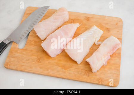 Raw Grouper Fillets on a Cutting Board - Stock Photo