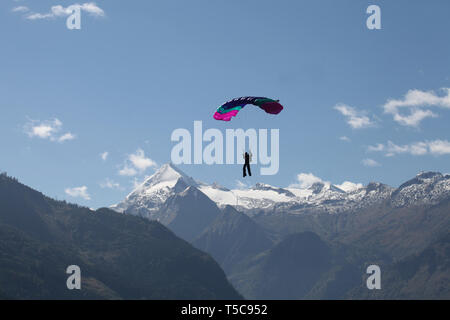 paraglider springer with maountains in the background - Austria Europe - Stock Photo