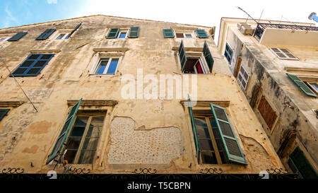 Windows of Weathered Apartment Building in Old Town, Corfu, Greece - Stock Photo