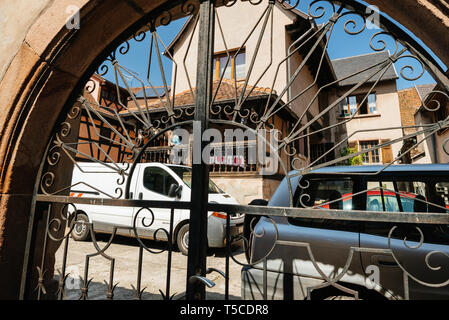 Bergheim, France - 19 Apr 2019: View from the street decoration at traditional house in central Aslatian village - Stock Photo