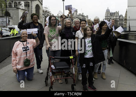 London, Greater London, UK. 23rd Apr, 2019. Baroness Jenny Jones (centre) walking to Parliament with ten Extinction Rebellion protester selected to deliver letters to the MPs.Extinction Rebellion protesters march from Marble Arch to Parliament Square, attempting to deliver letters to their MPs. Extinction Rebellion activists were permitted to be in Parliament Square but not to enter Parliament. After several attempts to deliver the letters, the activists reached an agreement with MPs through the police. Ten activists were allowed to deliver the letters in the company of Barones - Stock Photo