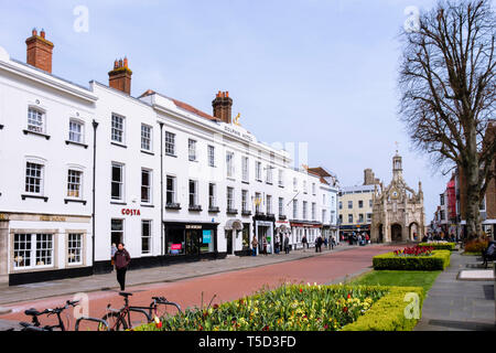 The old Market Cross and shops in old Dolphin Hotel Georgian building in city centre. West Street, Chichester, West Sussex, England, UK, Britain - Stock Photo