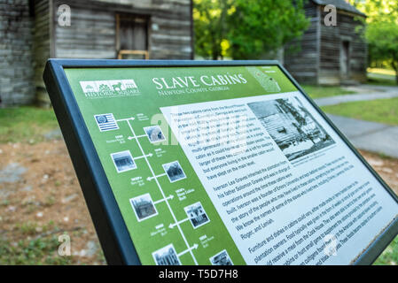 1830s Slave cabins from the Mount Pleasant Plantation in Covington, Georgia are preserved at Historic Square in Atlanta's Stone Mountain Park. (USA) - Stock Photo