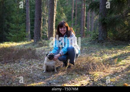 Woman with pug dog - Stock Photo