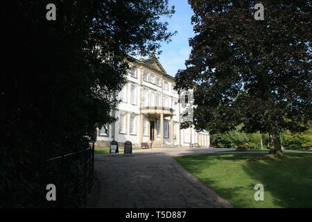 Sewerby Hall in Bridlington, East Riding of Yorkshire framed by green trees. - Stock Photo