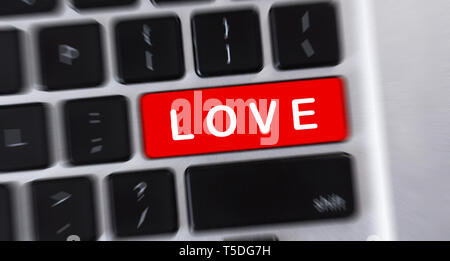 LOVE text on red button of computer keyboard - Stock Photo