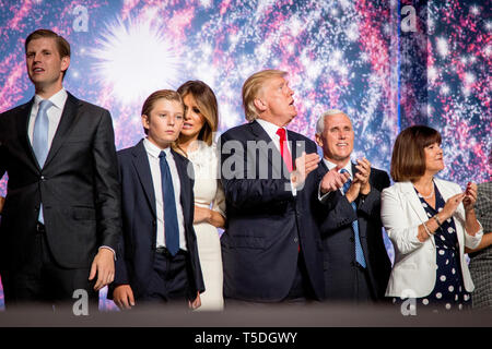 From left: Eric Trump, Barron Trump, Melania Trump, Donald J. Trump, Mike Penca and his wife Karen Pence celebrate on stage after Donald Trump was officially nominated as Republican Presidential Candidate at the Republican National Convention in Cleveland. - Stock Photo