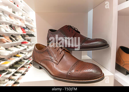 Elegant man shoes on store display - Stock Photo