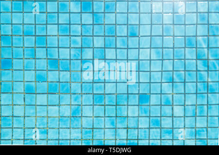 Blue ceramic tile mosaic in swimming pool - texture and background . - Stock Photo