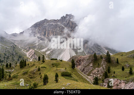 Italian Dolomites panorama as seen from the hiking trail on the Col Raiser plateau above the village of St. Cristina in the Gardena valley, South Tyro - Stock Photo