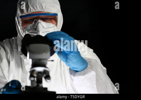 Chemistry Scientist Using Medical Microscope - Stock Photo