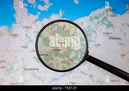 Berlin, Germany. Political map. City visualization illustrative concept on display screen through magnifying glass. - Stock Photo