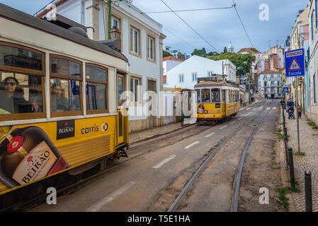 The famous Lisbon Tram 28 on Escolas Gerais street in Alfama district of Lisbon, Portugal - Stock Photo