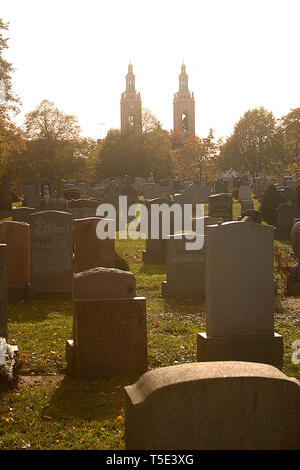 Linden Hill Methodist Cemetery in Ridgewood, NY, with view of  St Aloysius Roman Catholic Church in the background - Stock Photo
