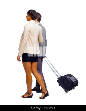 Back view of interracial going couple with suitcase. Rear view people collection. backside view of person. Isolated over white background. - Stock Photo