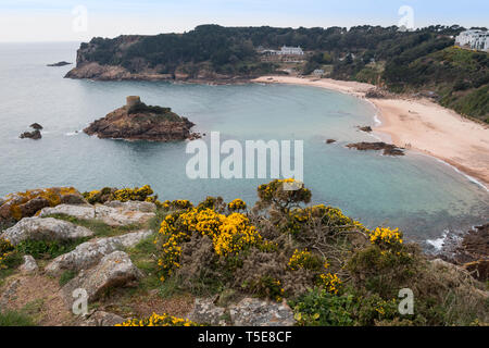 Janvin's Tomb and the bay at Portelet, Jersey, Channel Islands - Stock Photo