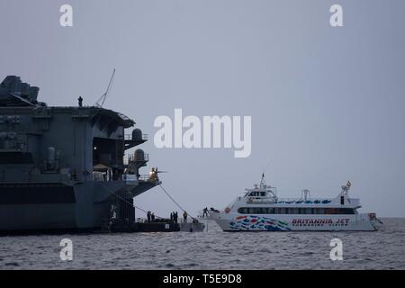 190418-N-WP746-0166 PALMA DE MALLORCA, Spain (April 18, 2019) Sailors aboard the Nimitz-class aircraft carrier USS Abraham Lincoln (CVN 72) tie up the ferry to prepare for liberty call as a part of a scheduled port visit. Abraham Lincoln is deployed with the Abraham Lincoln Carrier Strike Group deployment in support of maritime security cooperation efforts in the U.S. 5th, U.S. 6th, and U.S. 7th Fleet areas of operation. With Abraham Lincoln as the flagship, deployed strike group assets include staffs, ships and aircraft of Carrier Strike Group (CSG) 12, Destroyer Squadron (DESRON) 2, USS Leyt
