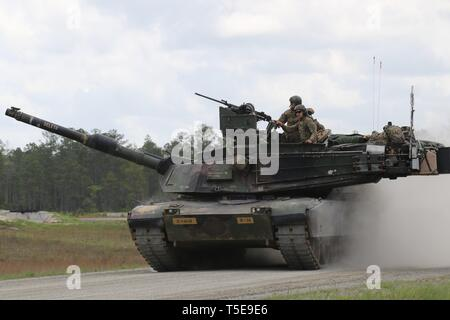 Soldiers from Company B, 1st Battalion, 64th Armor Regiment, 1st Armor Brigade Combat Team, roll back to the front of the range after completing their gunnery table five on April 11, 2019, Fort Stewart, Ga. Gunnery table five is a live fire exercise that tests tank crews on identifying and engaging targets with their weapon systems. - Stock Photo