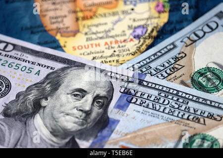 US dollars on the South Africa map. American investment and trading, South African economy - Stock Photo