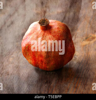 Vintage image with old dry pomegranate on wood background - Stock Photo