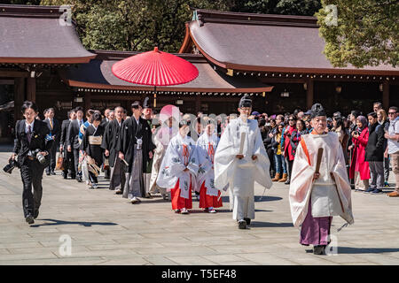 24 March 2019: Tokyo, Japan - Procession forming part of a traditional Shinto marriage ceremony at the Meiji Jingu shrine in Tokyo. - Stock Photo