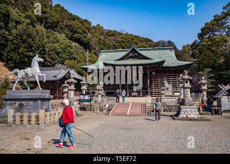 27 March 2019: Gamagori, Japan - Visitors at the Katahara Shinto Shrine, Gamagori. - Stock Photo