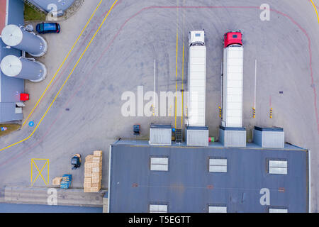 Aerial View of Loading Warehouse with Semi Trucks Parked - Stock Photo