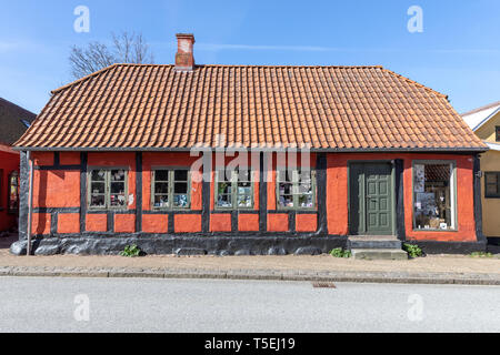 Old red and black half-timbered house in Algade, Saeby, in North Jutland, Denmark - Stock Photo