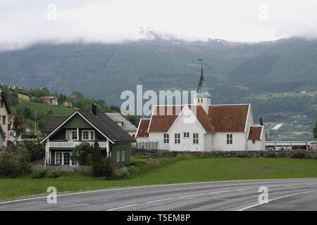 Settlement and church. Olden, Norway - Stock Photo