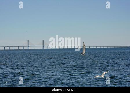 The Oresund Bridge crossing the Oresund Strait, connecting Copenhagen Denmark and Malmo Sweden, its the longest combined road and rail bridge in Europ - Stock Photo