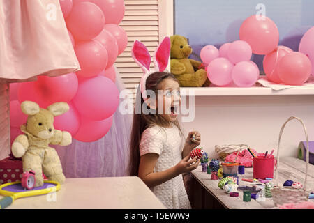 Different color Easter Eggs in a child's hands - Stock Photo