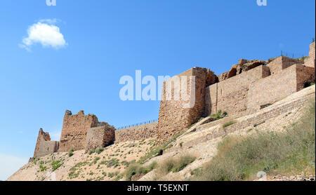 Kerak castle as seen from the valley below. - Stock Photo