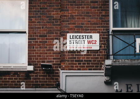 London, UK - April 13, 2019: Leicester Street name sign on a building wall in the City of Westminster, borough that occupies much of the central area  - Stock Photo