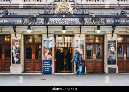 London, UK - April 13, 2019: People walking by Her Majesty Theatre, a theatre in West End of London whose name changes depending on the gender of the  - Stock Photo