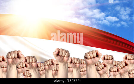 Labor Day concept with fists of men against the background of the flag of Netherlands - Stock Photo