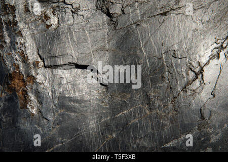 The surface of Slate shining in sunlight.  Pictured in the now closed Ballachulish slate quarry in western Scotland. - Stock Photo