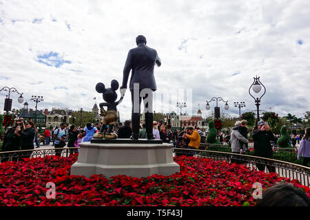 Orlando, FL/USA - 02/10/18: Horizontal back view of Walt Disney and Mickey Mouse Partners statue overlooking Main Street USA at Disney World. - Stock Photo