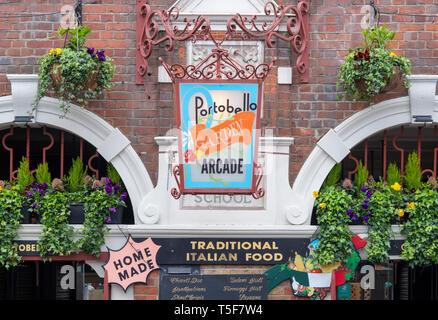 Portobello garden arcade exterior. Italian Restaurant in Portobello Road, Notting Hill, London, England - Stock Photo