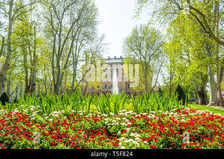 Zagreb, Croatia, park Zrinjevac and academy of science and arts palace in background, beautiful spring day, popular tourist destination - Stock Photo