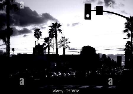 Road traffic on Santa Monica Boulevard during the sunset. - Stock Photo